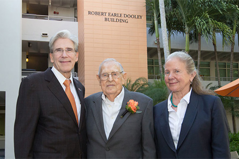 Alumnus Robert Dooley, flanked by UM President Julio Frenk and Law School Dean Patricia White
